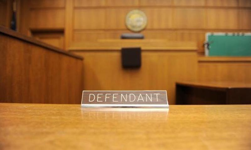 A view of the defendant's table in a courtroom.—AFP/File