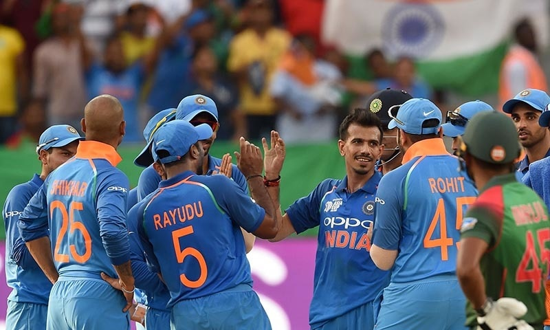 Indian cricketer Yuzvendra Chahal (C) celebrates with his teammates after he dismissed Bangladesh batsman Imrul Kayes. — AFP