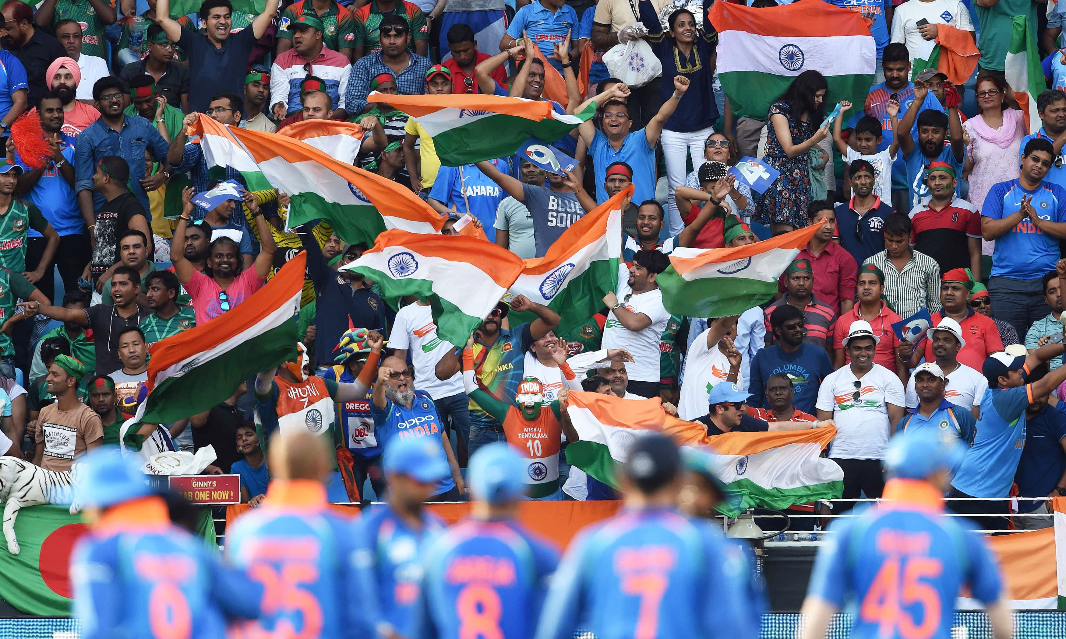 Indian cricket fans cheer in support of their national team. —AFP