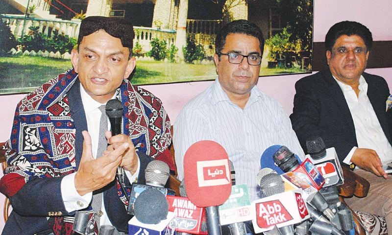 Dr Hassan Abbas makes a gesture during media talk at the press club on Friday. — Dawn