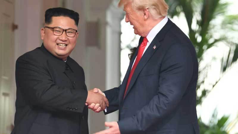 North Korean leader Kim Jong Un and President Donald Trump at the start of their historic summit held in June. — AFP