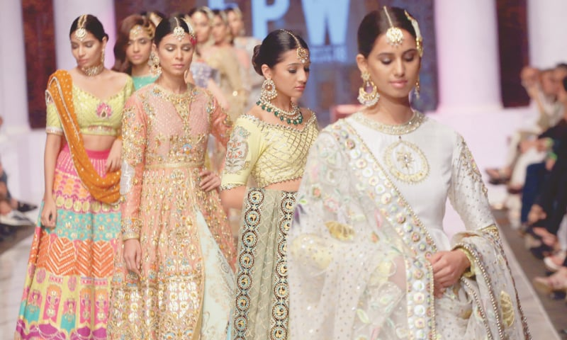 MODELS display a collection  of dresses on day two of the Fashion Pakistan Week  Winter/Festive '18. —White Star