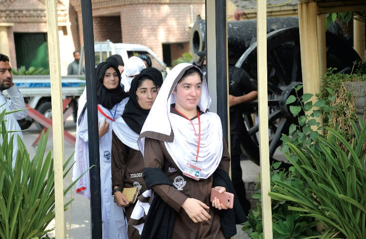 Students leave after visiting the Governor's House, Peshawar, on Sunday after its was opened to general public. — White Star