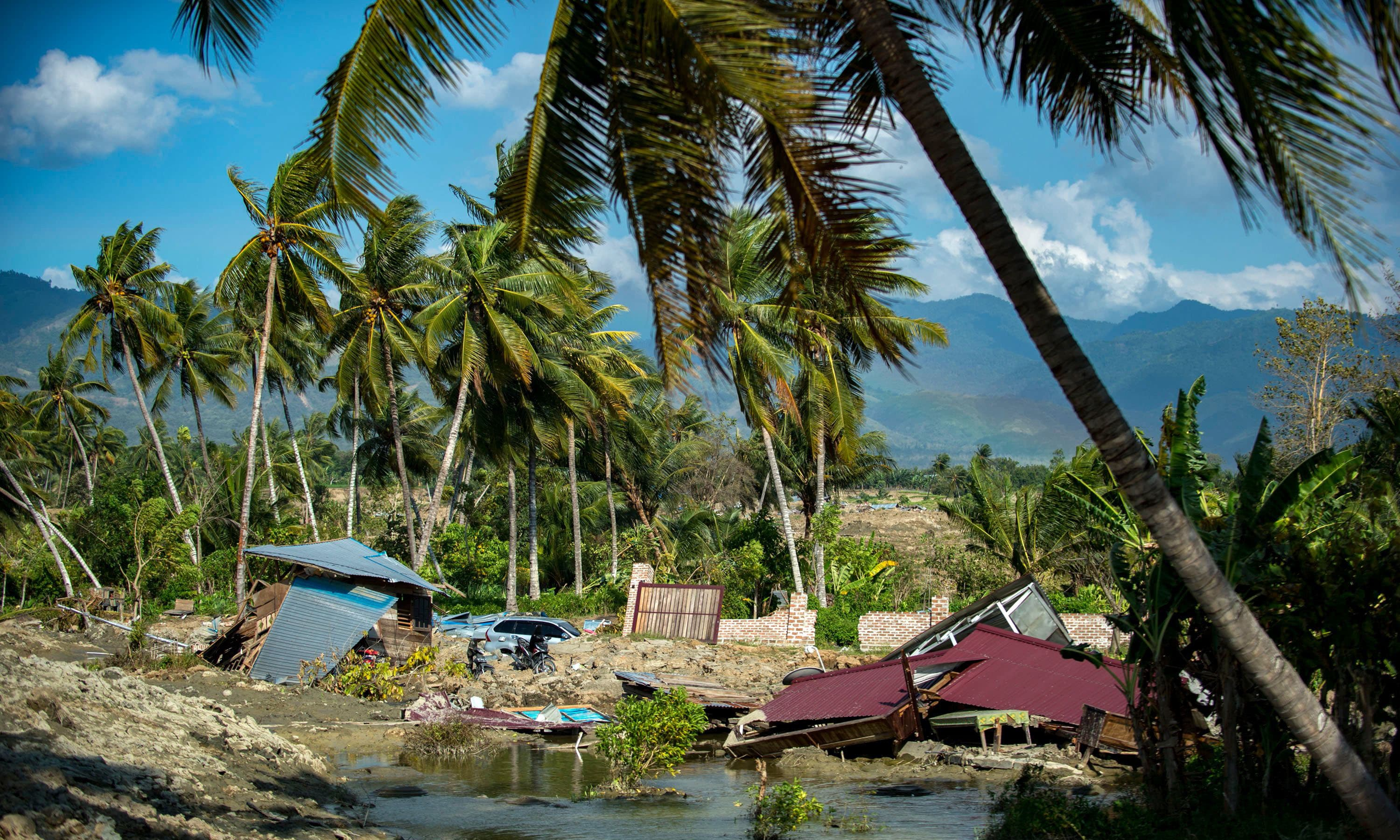 Destroyed houses and debris are seen in a village near Palu after an earthquake and tsunami hit the area on September 28. — AFP