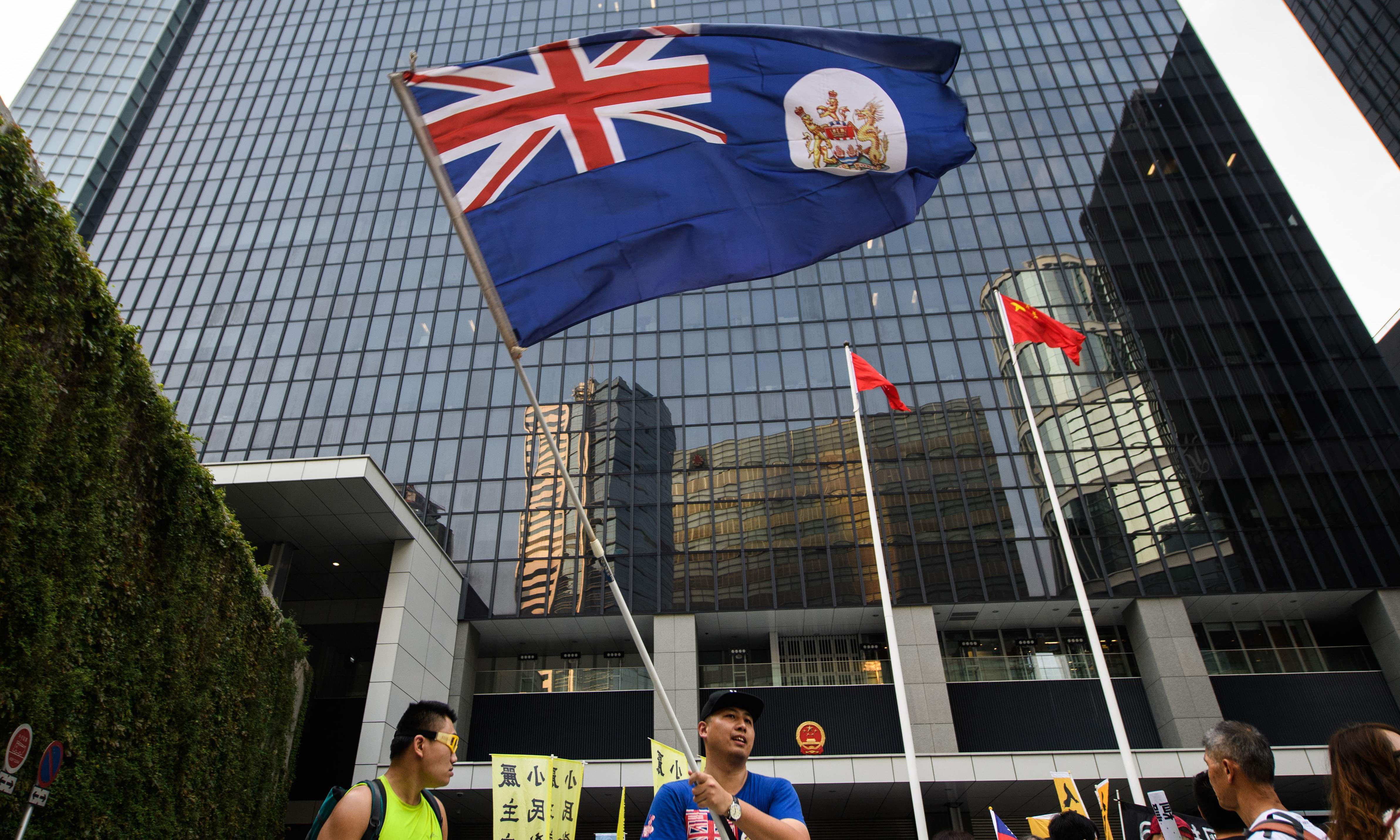 Thousands protest in Hong Kong over China suppression