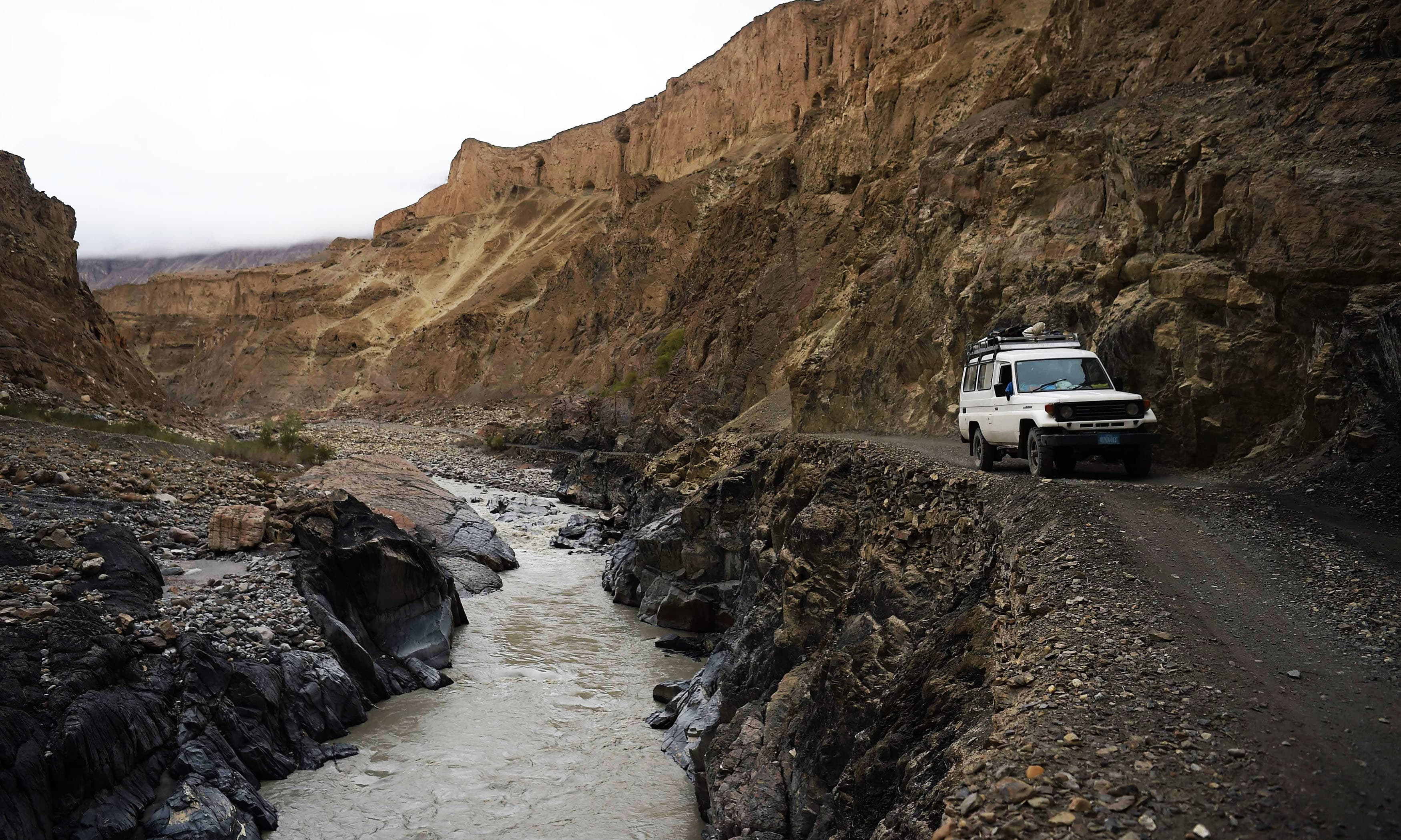The precarious roads of Pakistan's mountainous north are lifelines for its scattered and remote population. —AFP