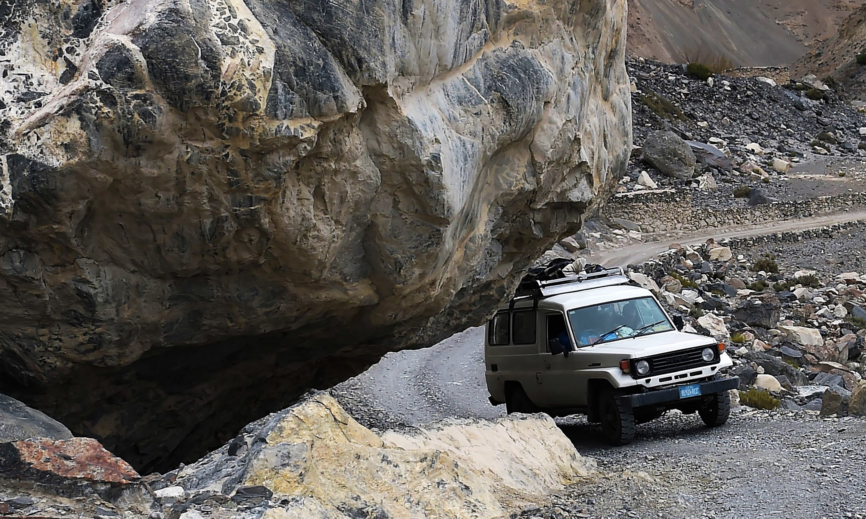 Passengers travel in a vehicle in Shimshal valley of Hunza district in northern Pakistan. —AFP