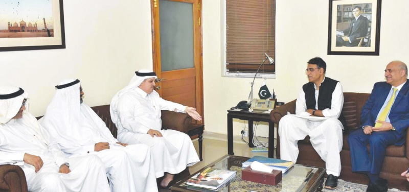 ISLAMABAD: Adviser to Saudi Arabia's ministry of energy, industry and mineral resources Ahmad Hameed Al-Ghamdi talks to Finance Minister Asad Umar during a meeting on Monday.—APP