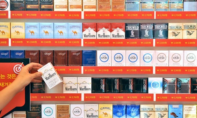 A display of various brands of cigarettes. ─ AFP/File
