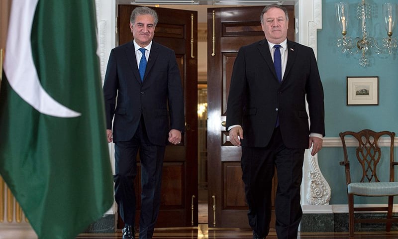 US Secretary of State Mike Pompeo (R) meets with Foreign Minister Shah Mehmood Qureshi at the US State Department in Washington, DC on Tuesday. — AFP