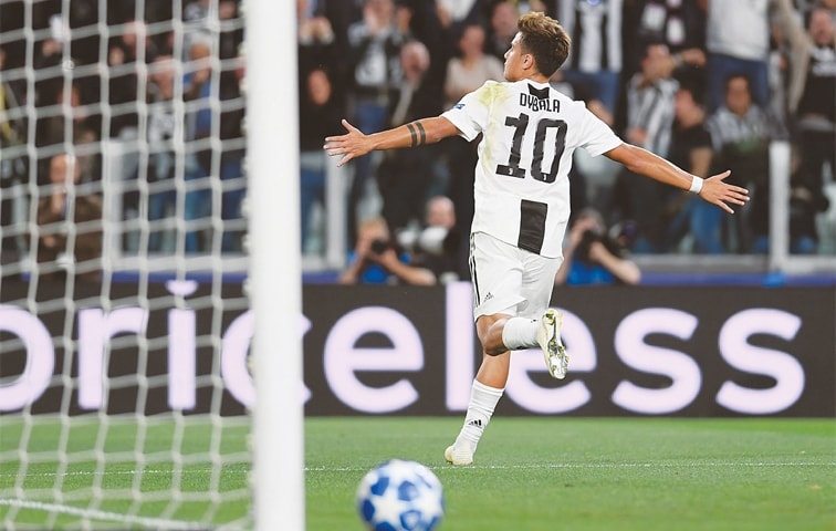 TURIN: Juventus' Paulo Dybala celebrates after scoring against Young Boys during the Group 'H' match at the Allianz Stadium.—AFP