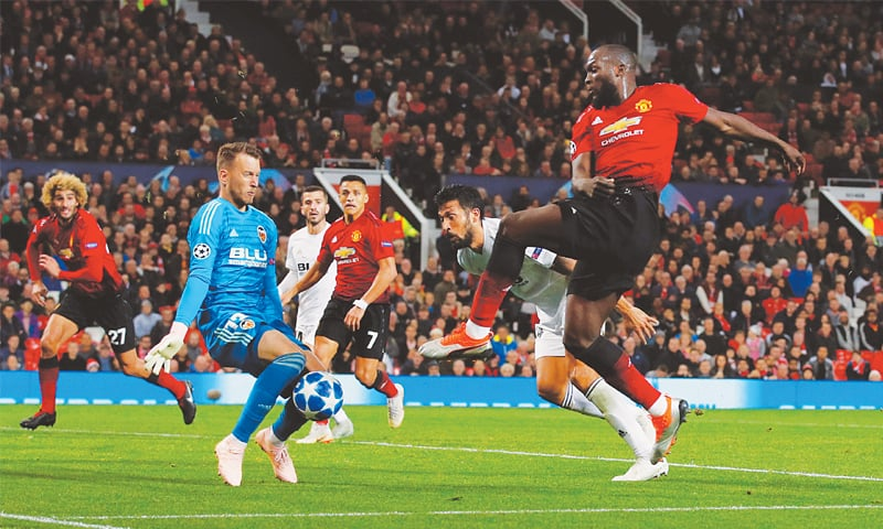 MANCHESTER: Valencia goalkeeper Neto saves a shot by Manchester United's Romelu Lukaku (R) takes a shot during their Group 'H' match at Old Trafford.—Reuters