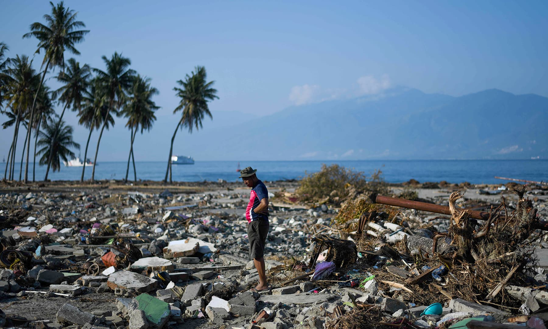 A quake survivor stands among the debris of his neighbourhood in Wani, Indonesia's Central Sulawesi. — AFP