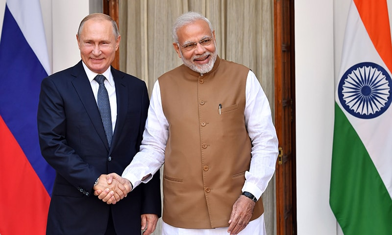 Indian Prime Minister Narendra Modi (R) welcomes Russian President Vladimir Putin prior to their meeting at Hyderabad House in New Delhi. —AFP