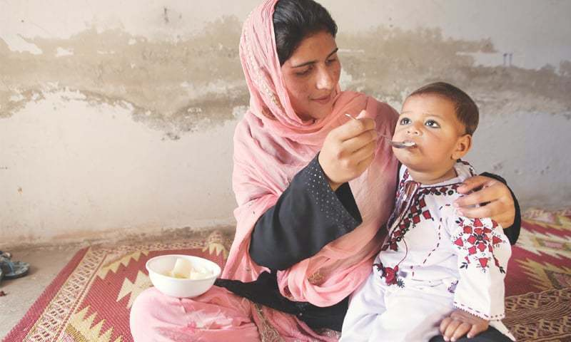 A Unicef file photo of a mother in Muzaffargarh feeding her child.