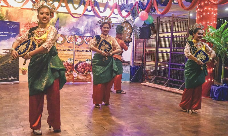 A MALAYSIAN troupe performs a traditional dance on Friday evening.—White Star
