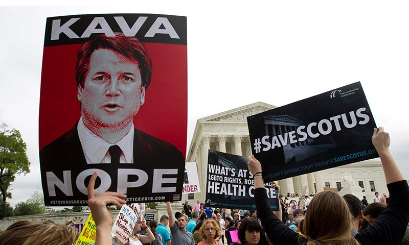 Protesters against US Supreme Court nominee Brett Kavanaugh demonstrate at the US Supreme Court in Washington, DC, on Saturday. — AFP