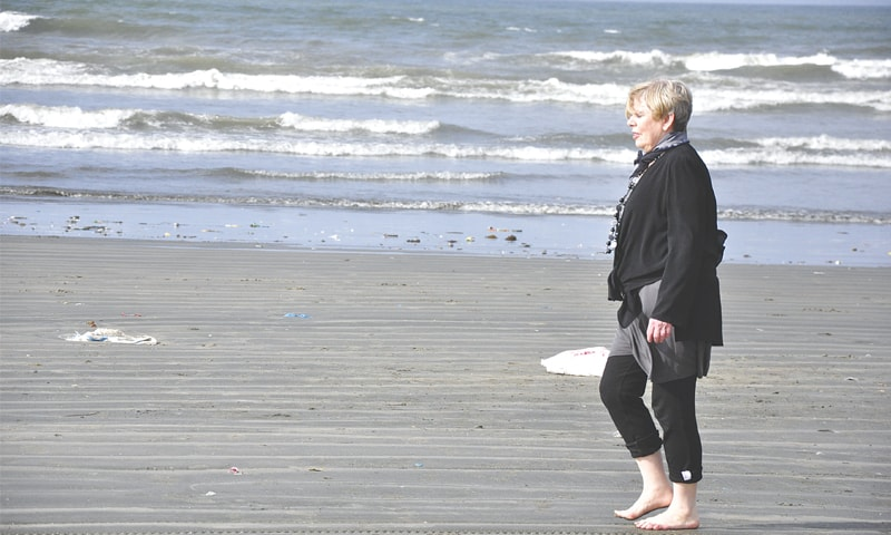 Strolling on the beach during her visit to Karachi in 2011