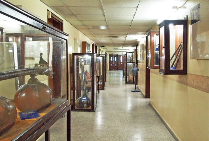 The hallway of the production unit at Radio Pakistan headquarters, where musical instruments used by various artists are exhibited.