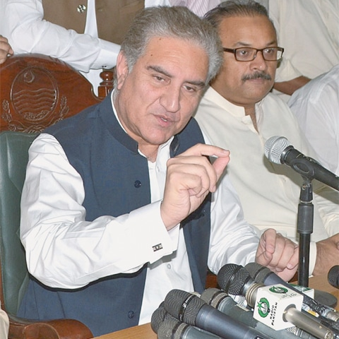 Foreign Minister Shah Mehmood Qureshi speaks to reporters on Saturday.—APP