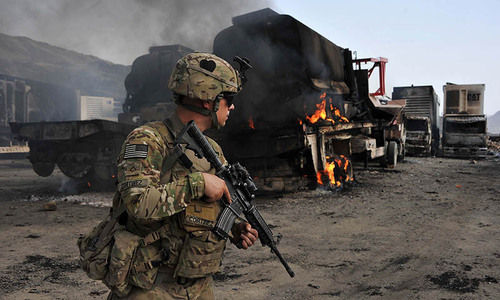 A US soldier inspects the site of a suicide attack in Afghanistan's Nangarhar province. ─AFP/File