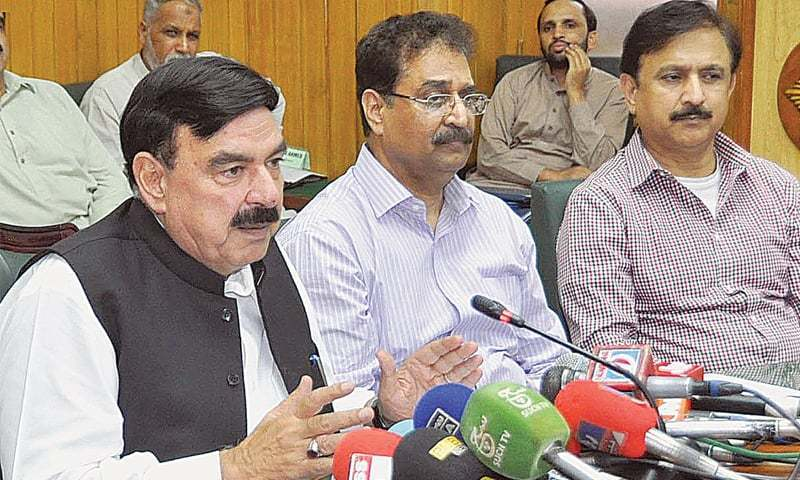 Railways Minister Sheikh Rashid Ahmed addresses a press conference. ─ INP/File