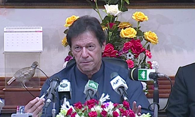 PM Khan talks to media persons in Lahore. —DawnNewsTV