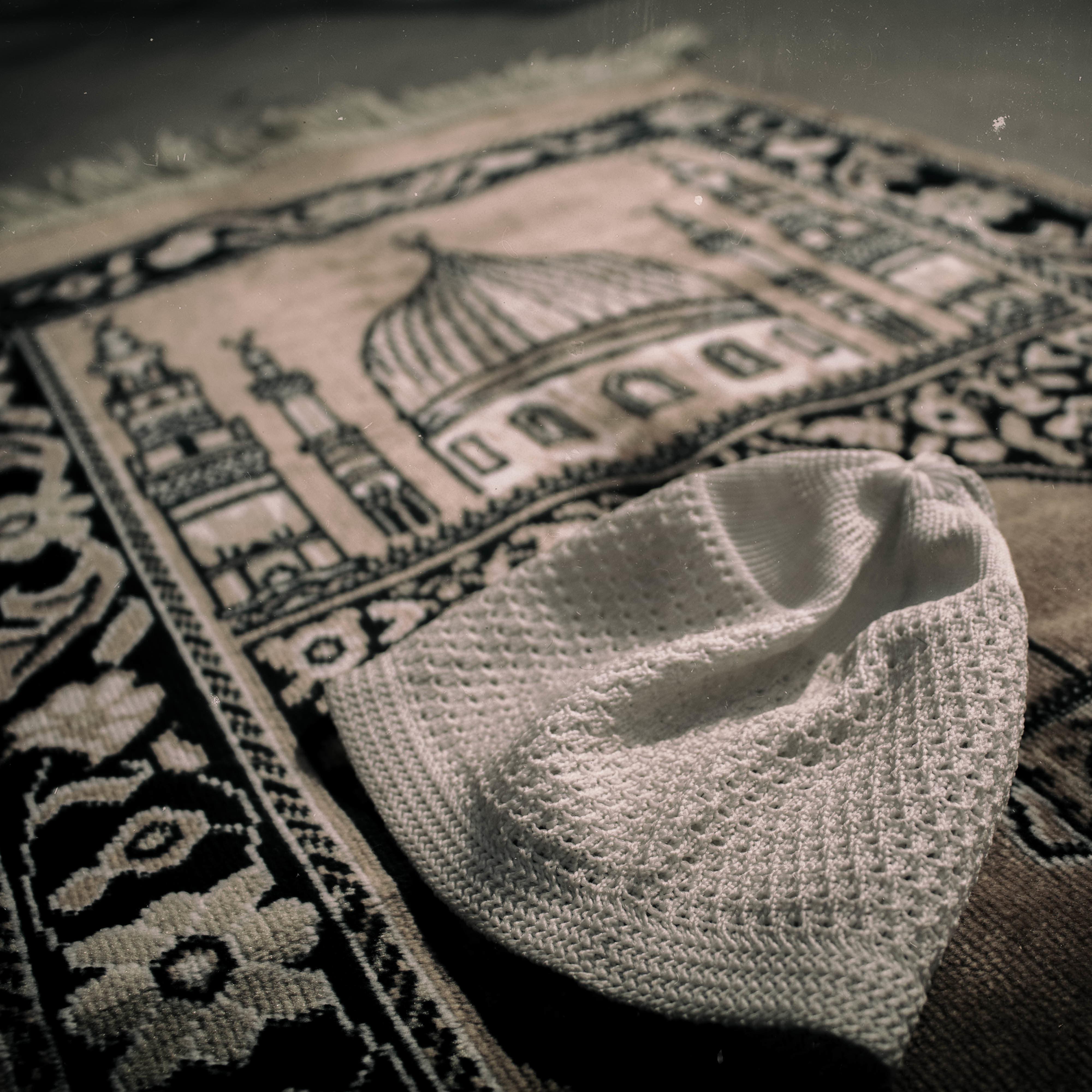 Prisoner Z's prayer mat and cap.—JPP