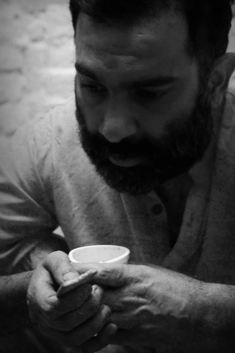 Prisoner Z at his lunch of tea and biscuits.—JPP