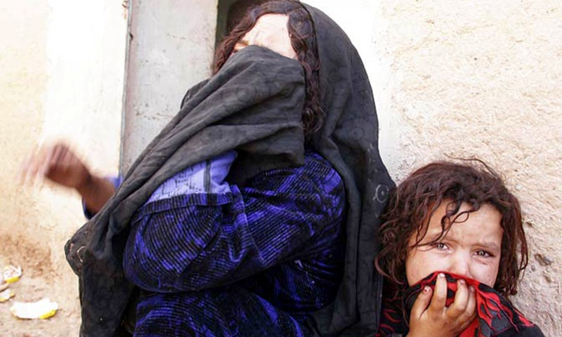 In this Aug. 23, 2008 file photo, an Afghan woman and her daughter wail after their relative was killed in an air strike in Azizabad village in the Shindand district of Herat province.