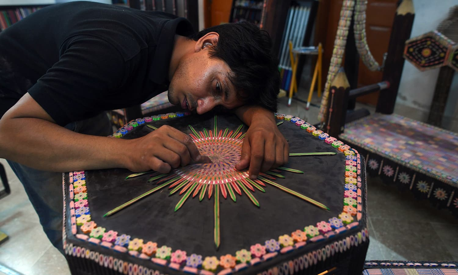 Bilal Asif fine-tunes his creation at his studio in Karachi. — AFP