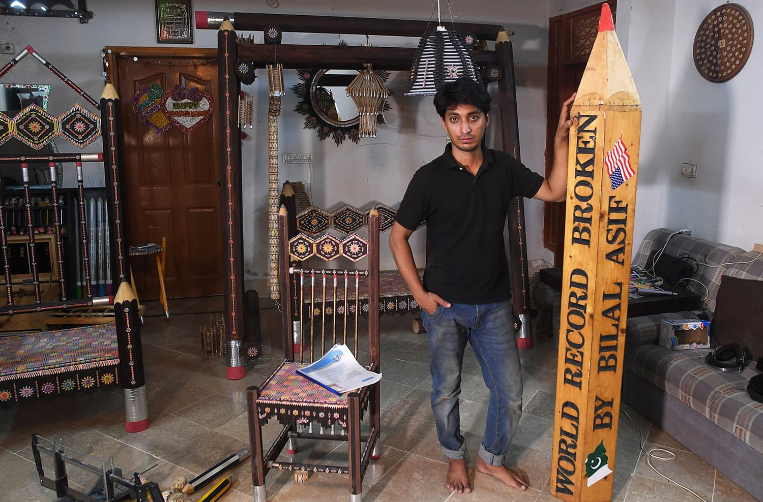 In this October 4, 2018, photo, artist Bilal Asif poses for a photograph with his pencils art work at his studio in Karachi. — AFP
