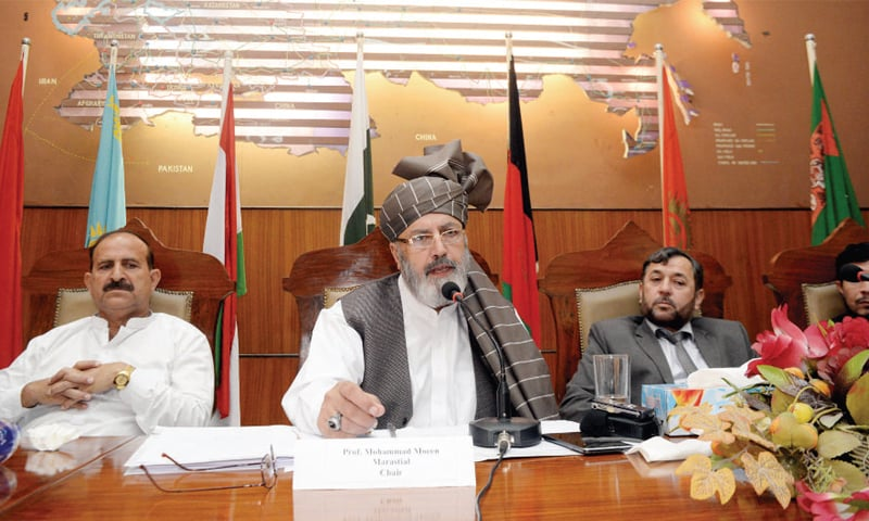 Afghan counsul general Prof Mohammad Moeen Marastial  addresses a conference on sustainable use of Kabul River water at Peshawar University on Wednesday. — White Star