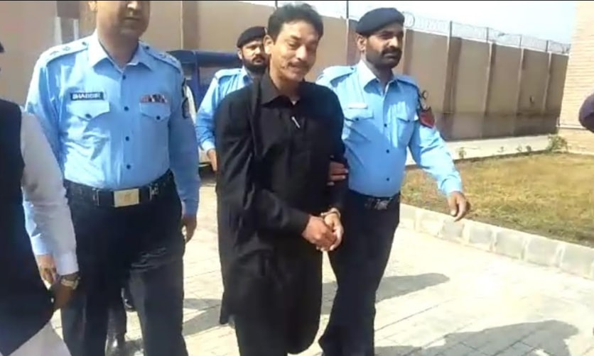 Faisal Raza Abidi arriving at the ATC court in handcuffs. — Photo courtesy author