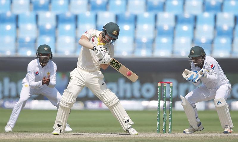 DUBAI: Australian batsman Travis Head plays a shot during the first Test against Pakistan on Thursday.—AP