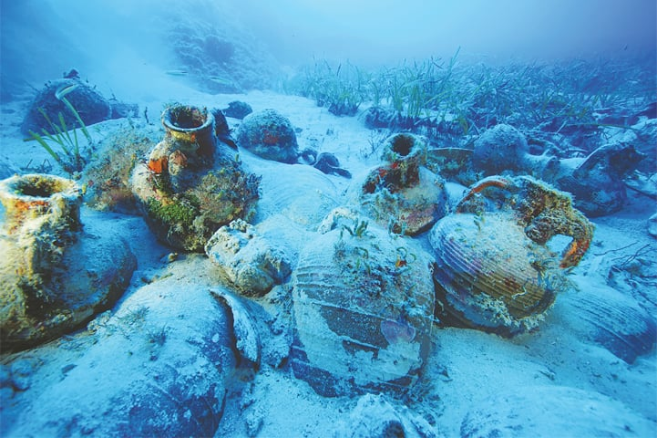Amphorae are seen at the sea bottom at a shipwreck site on the island of Fournoi, Greece.—Reuters