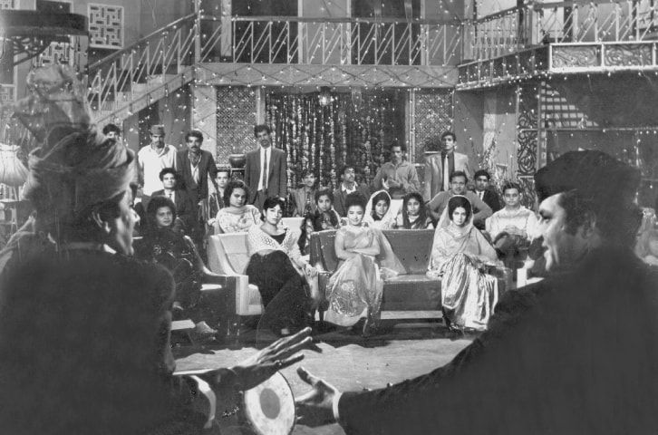 An entertaining qawwali from the Pakistani film Aag (1967), 'Liye aankhon mein ghuroor' shows Mohammad Ali  (R) and Lehri trying to attract the attention of Zeba. Ahmed Rushdi lent his voice to both
