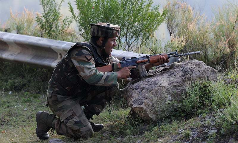 An Indian army soldier takes up position near the Line of Control. —File