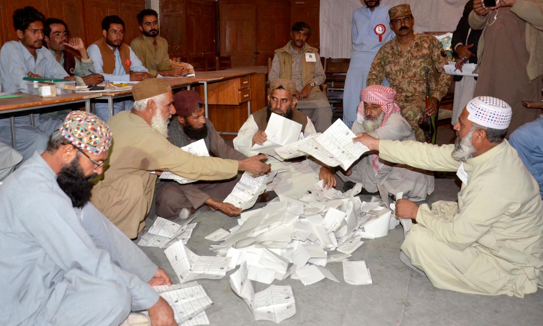 Polling staff counts the votes after polling ended in NA-35 constituency of Mastung area. —APP