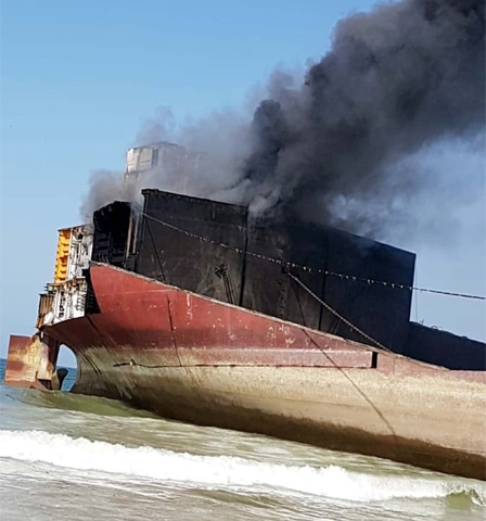 SMOKE billows from the oil tanker.—PPI