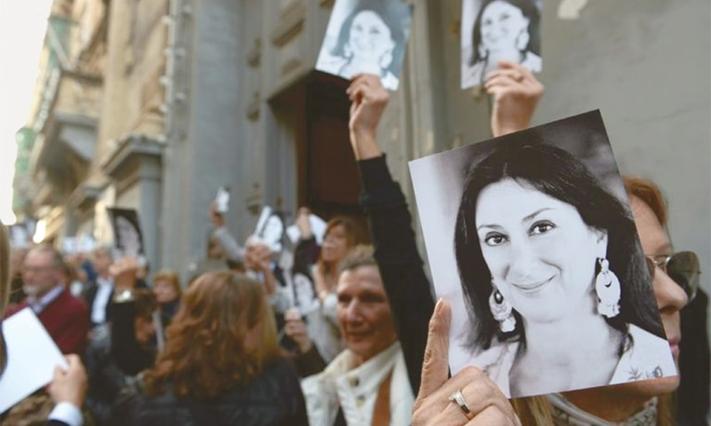 Supporters of Maltese anti-corruption journalist Daphne Caruana Galizia hold a vigil for her on the 16th of every month. —AFP