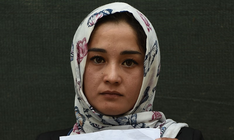 Kabul university student Zahra Faramarz, 21, says she will vote despite being anxious about security. — AFP
