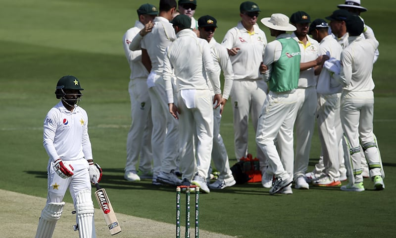 Pakistan's Muhammad Hafeez leaves after being dismissed by Australia's Mitchell Starc during their test match in Abu Dhabi. — AP