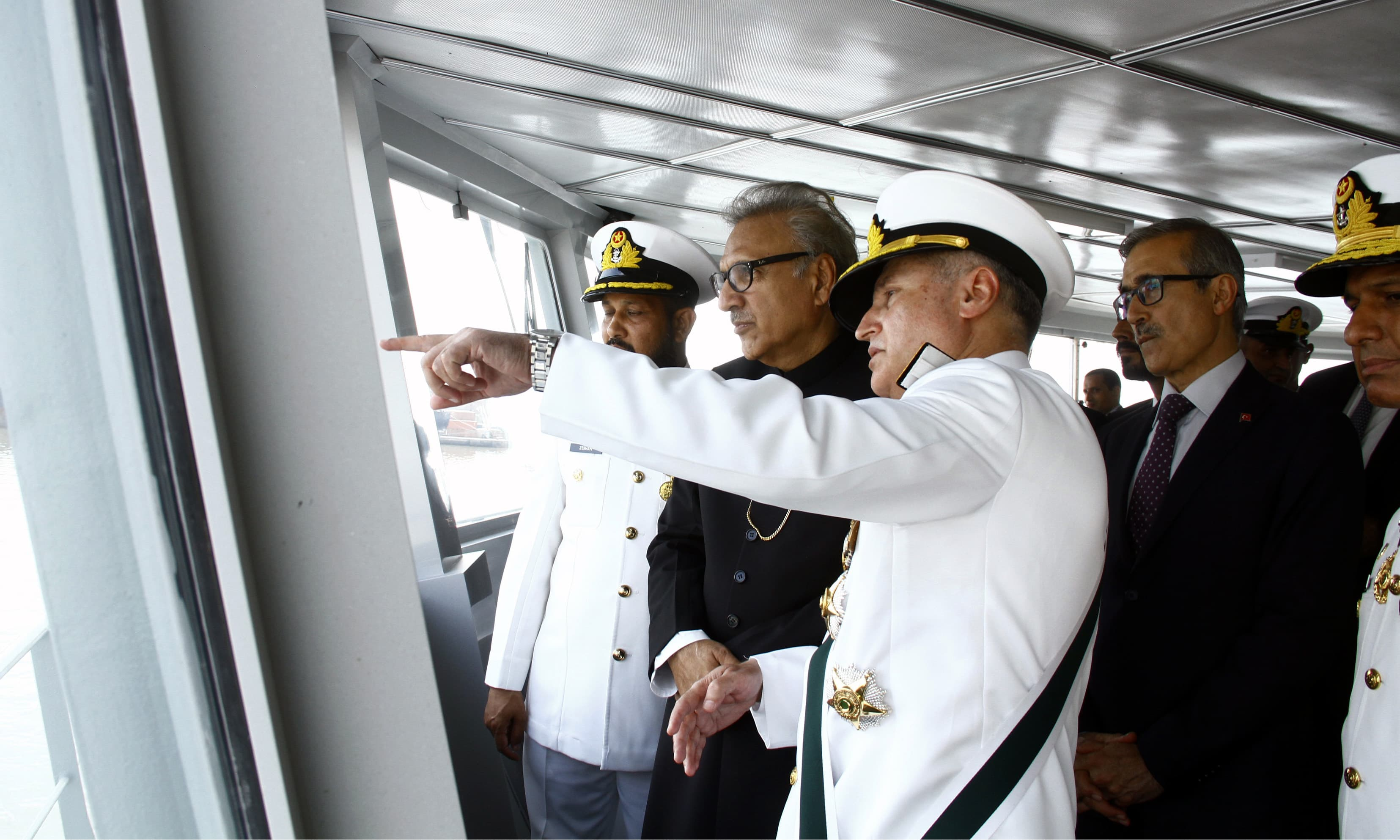 Naval Chief Admiral Zafar Abbasi briefs President Alvi about the newly built ship. —Navy PR