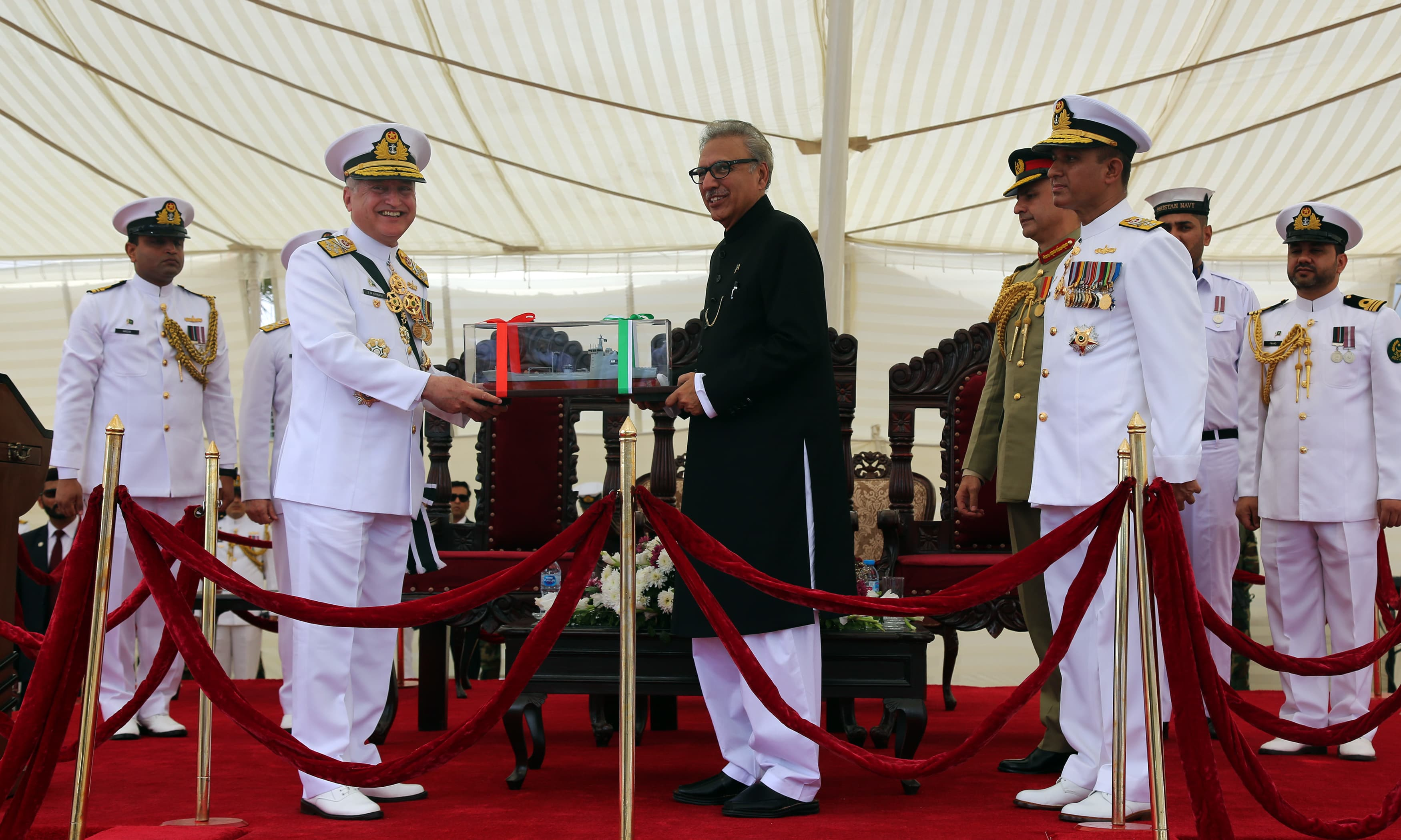 Admiral Z M Abbasi presents a model of PNS Moawin to President Arif Alvi. —Navy PR