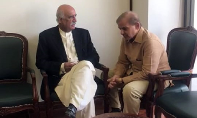 Shahbaz Sharif meets PPP leader Khursheed Shah in his chamber. — Photo courtesy Fahad Chaudhry