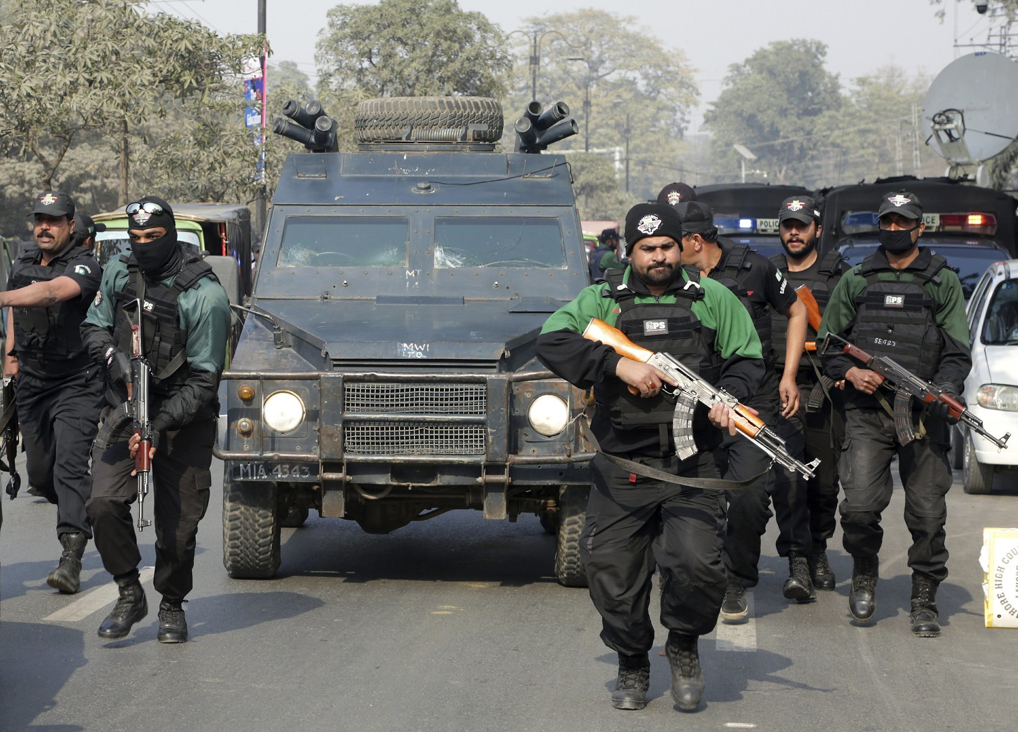 In this Feb 7 file photo, Pakistani police commandos escort a police van carrying Mohammad Imran as it arrives at ATC in Lahore. ─AP