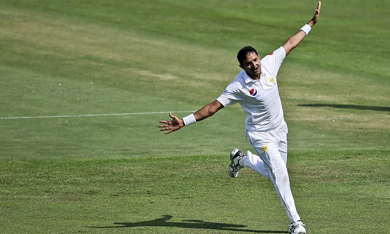 Mohammad Abbas celebrates dismissal of Australia's Shaun Marsh during their test match in Abu Dhabi. — AP