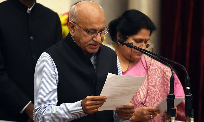 In this file photo taken on July 5, 2016 BJP politician M.J. Akbar takes the oath during the swearing-in ceremony of new ministers following Prime Minister Narendra Modi's cabinet re-shuffle at the Presidential Palace in New Delhi. — AFP