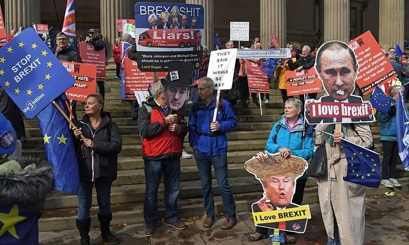 This file photo shows Anti-Brexit protesters gathered with placards ahead of a march through the centre of Liverpool on September 23.